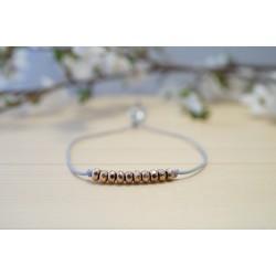 bracelet en hématite or rose et cordon gris bleuté